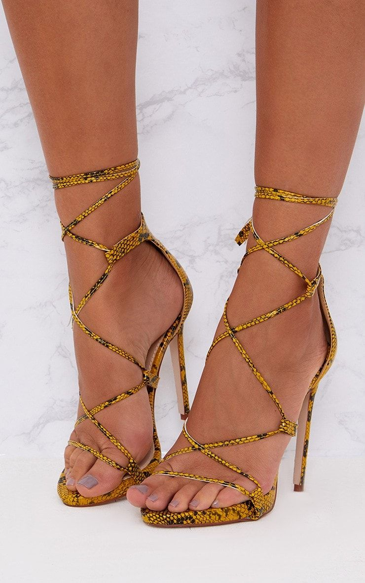 bfa26f8f60d5 Yellow Snake Print Single Strap Heeled SandalsAdd a staple pair of snake  print heels to your coll.