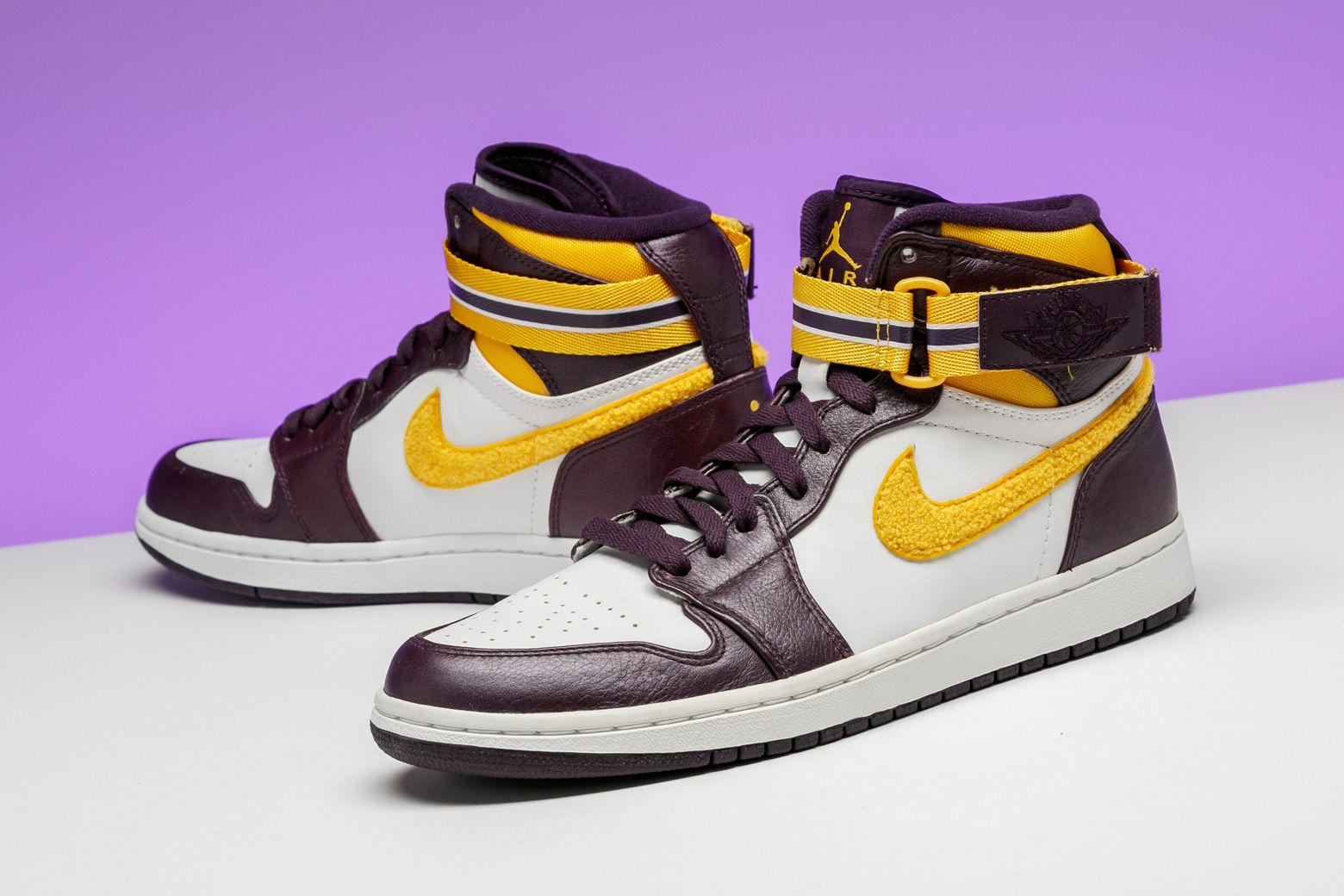 new concept 61863 0616b Jordan Brand coated this 2009 Air Jordan 1 High Strap with a LA Lakers  color scheme.