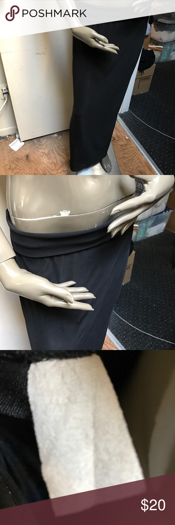 """Black skirt long with roll down waist band Super long curve hugging black skirt. Measures at waist band with band rolled down 16"""" un stretched 18 stretched approx 38 1/4 inches long with waist band rolled down. Approx 14 1/2 inch back slit.  As you can see label is blank. Skirts Maxi"""