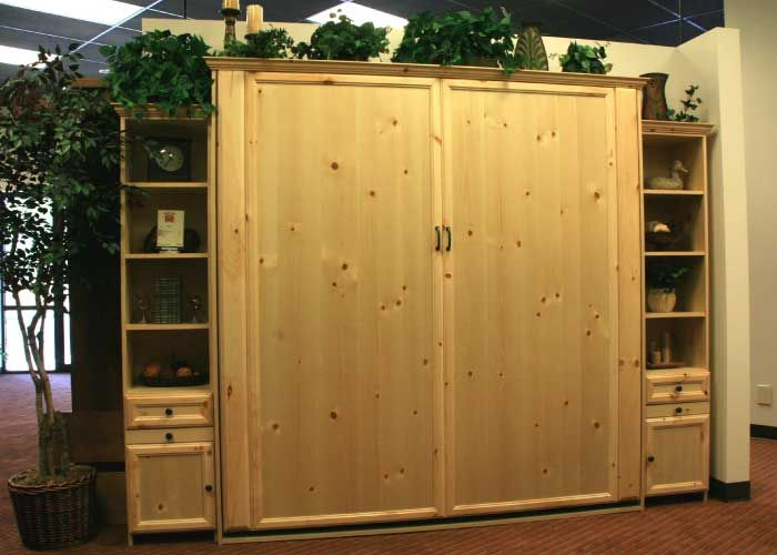 This is a King size Aspen style Murphy bed in Knotty Pine wood with Natural finish.