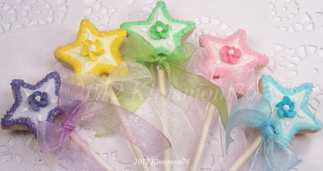 The wands were just small star shapes baked with a small cookie stick. I added the ribbon with a twist tie so it was easy to remove.