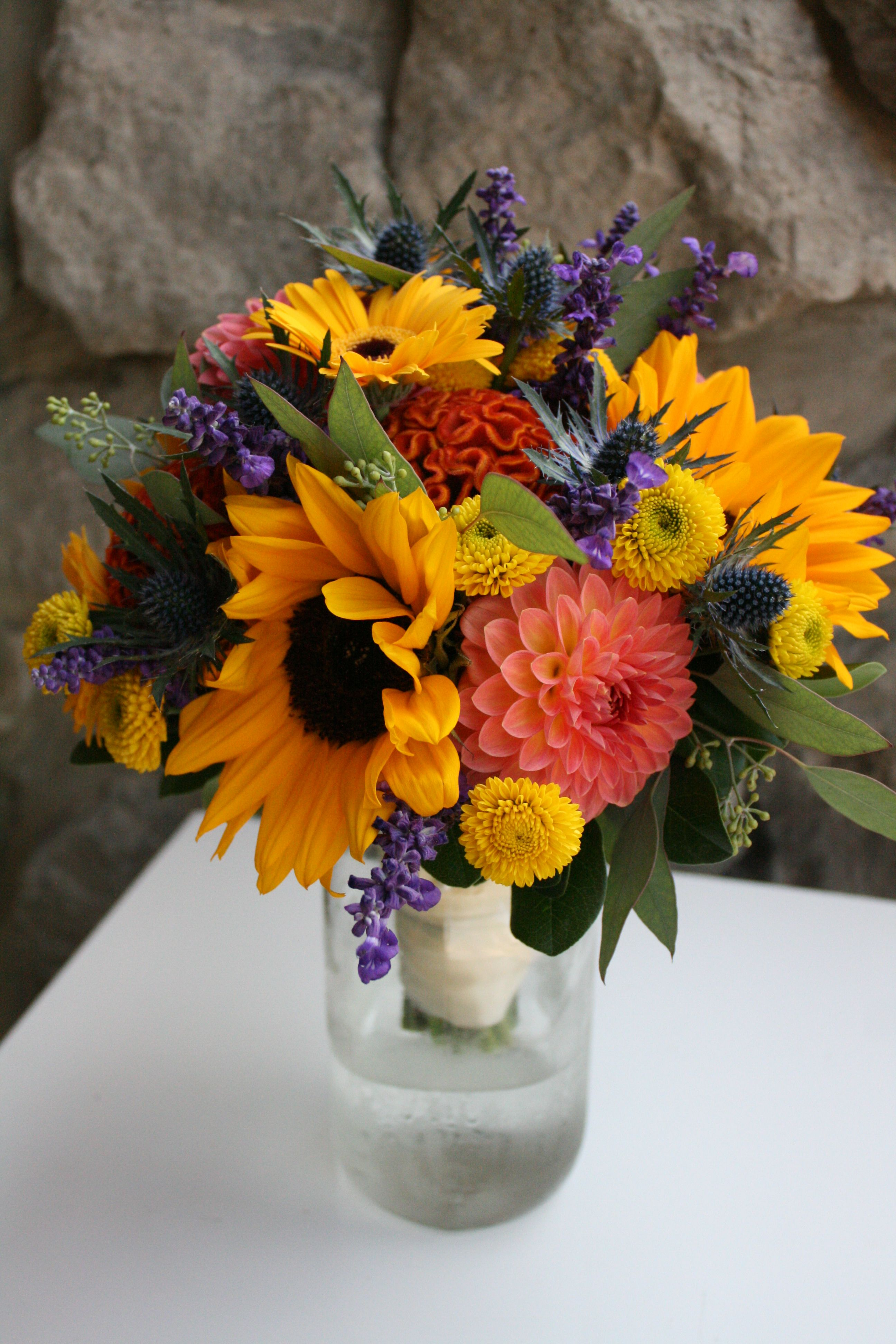Summer bouquet of dahlia, sunflowers, celosia and salvia