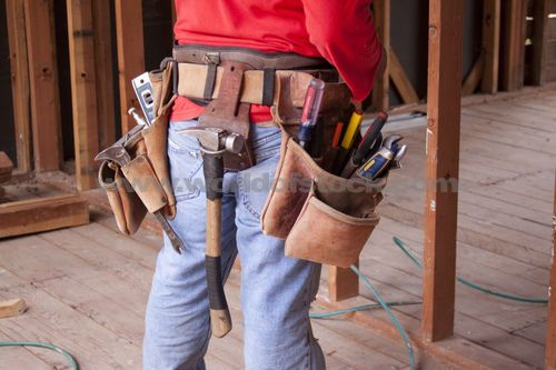 Stock Photograph of Carpenter Wearing A Leather Tool Belt With An ...