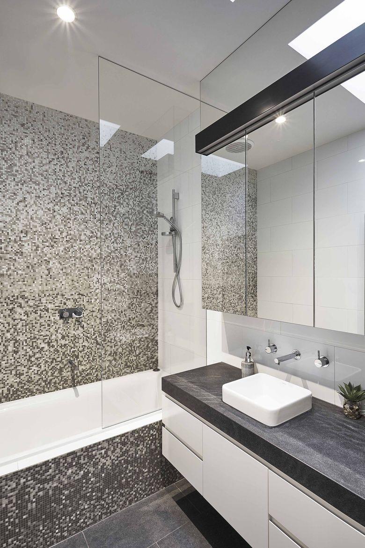 Interior design of bathroom renovated bathroom with a matteblack quartz countertop  modern