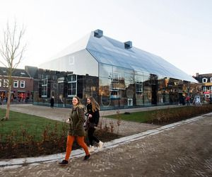 MVRDV has completed the Glass Farm, a multifunctional building with exterior wall made from glass printed, located in the market square of the small Dutch town of Schijndel.