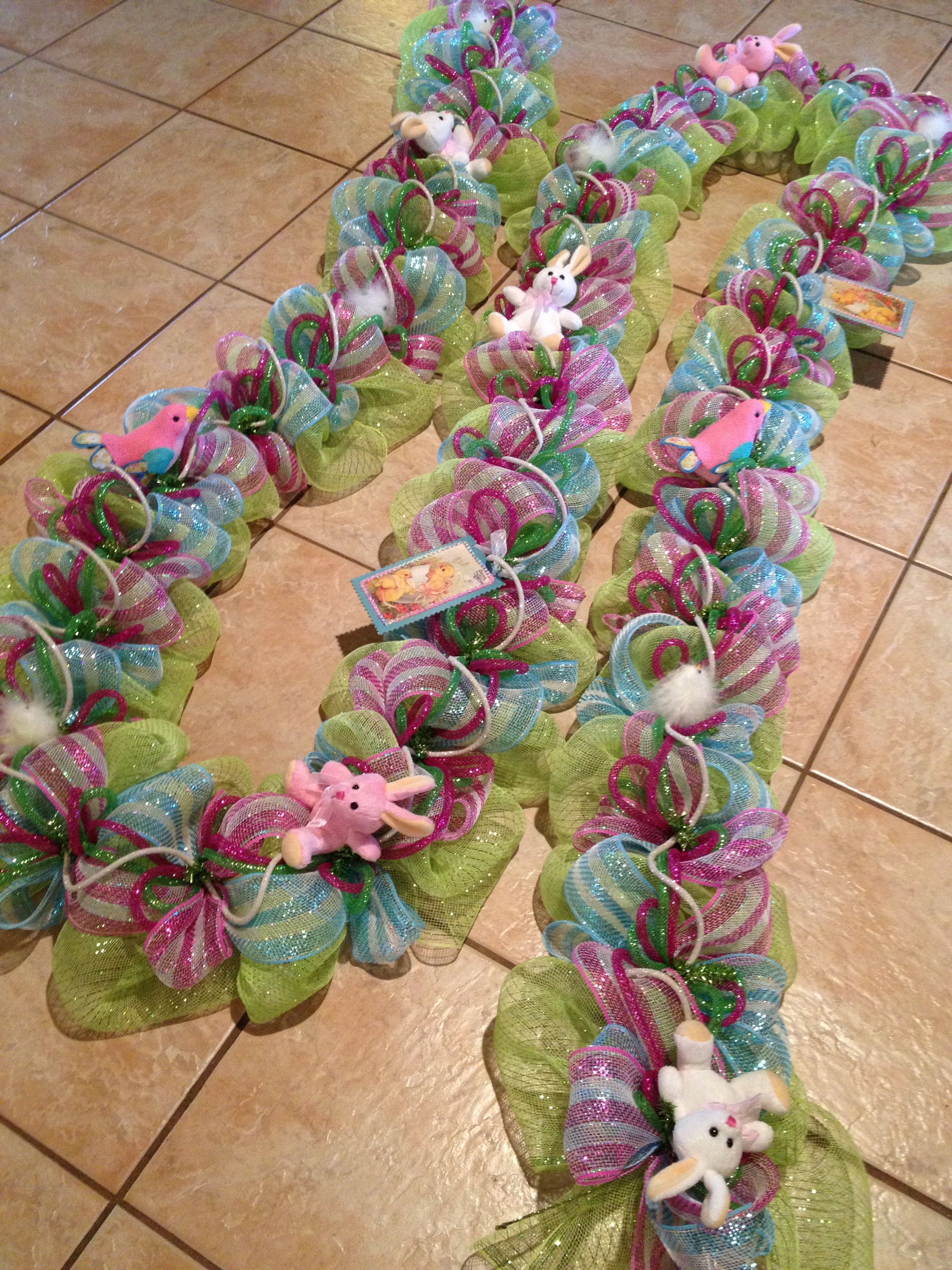 Fully decorated Spring into Easter staircase garland. Find