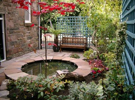 Small courtyard garden with raised pond in Kirklee in ...
