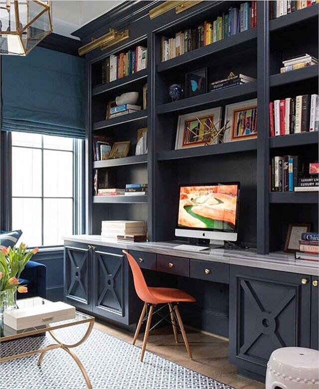 A home office like this would definitely make work days Built in home office designs
