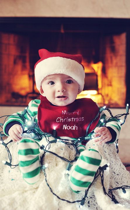 """It's difficult to make the holidays look fun when the baby's best expression of the day is """"bewilderment"""". (Some of you may know baby Noah!) (copyright Betsy Limbaugh Photography)"""
