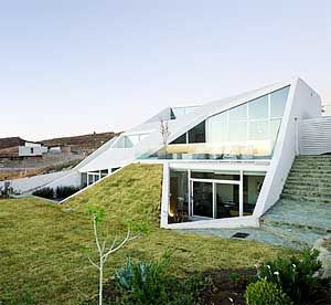 Earth berm homes use the natural landscape to help Earth bermed homes