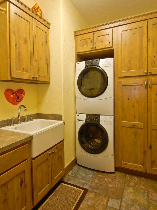 traditional laundry room stacked washer and dryer design pictures