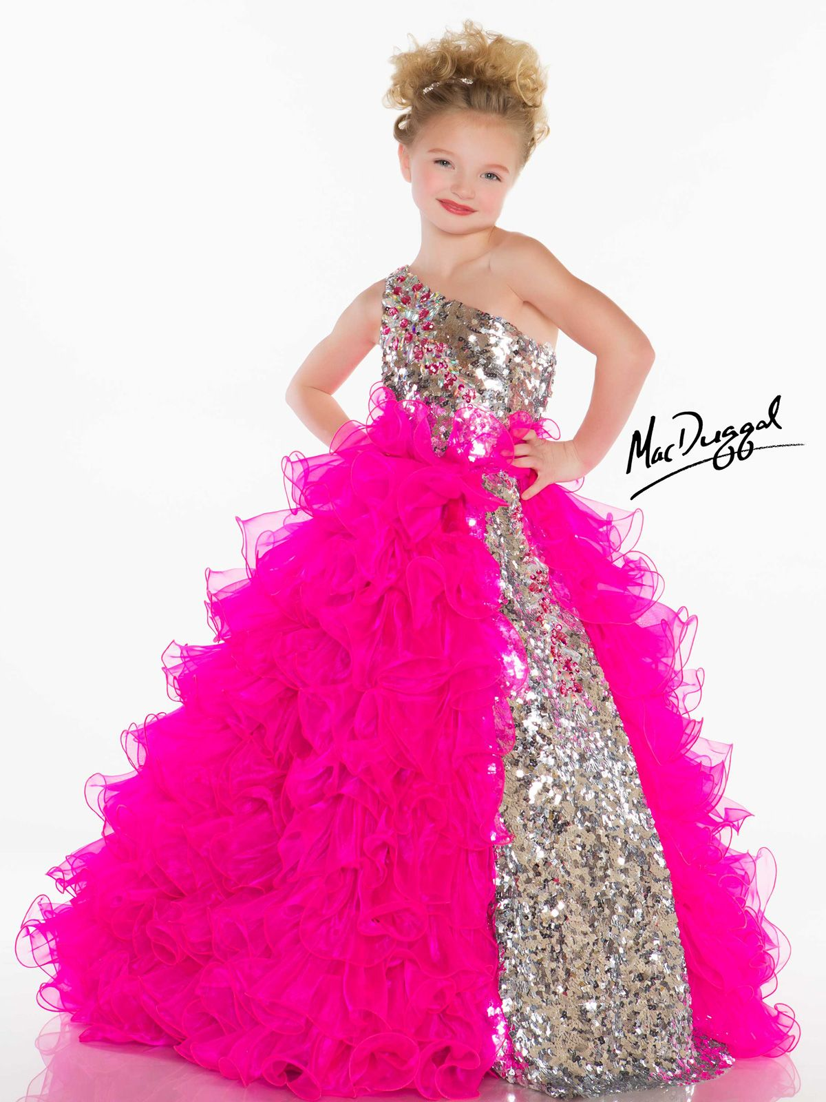 Eye-catching, stunning and glittering describe the beauty of this little  girls pageant gown