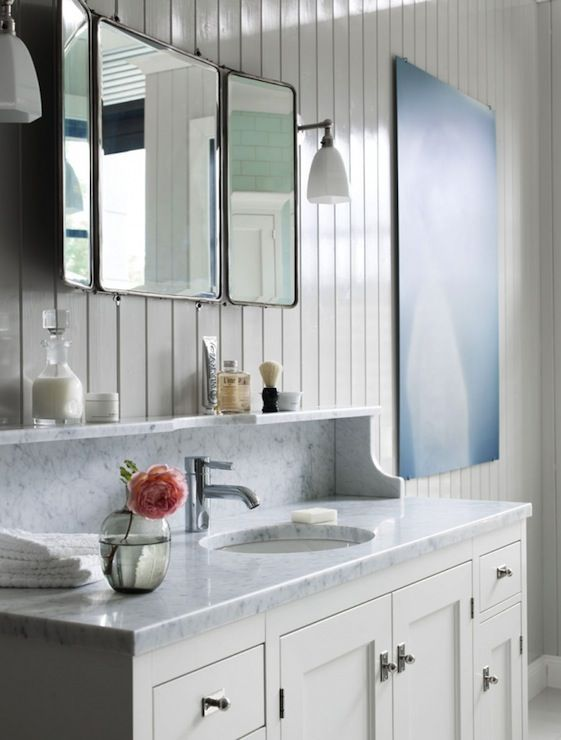 Picture Gallery Website Kvanum Chic bathroom with beadboard backsplash folding mirror and white bathroom vanity with