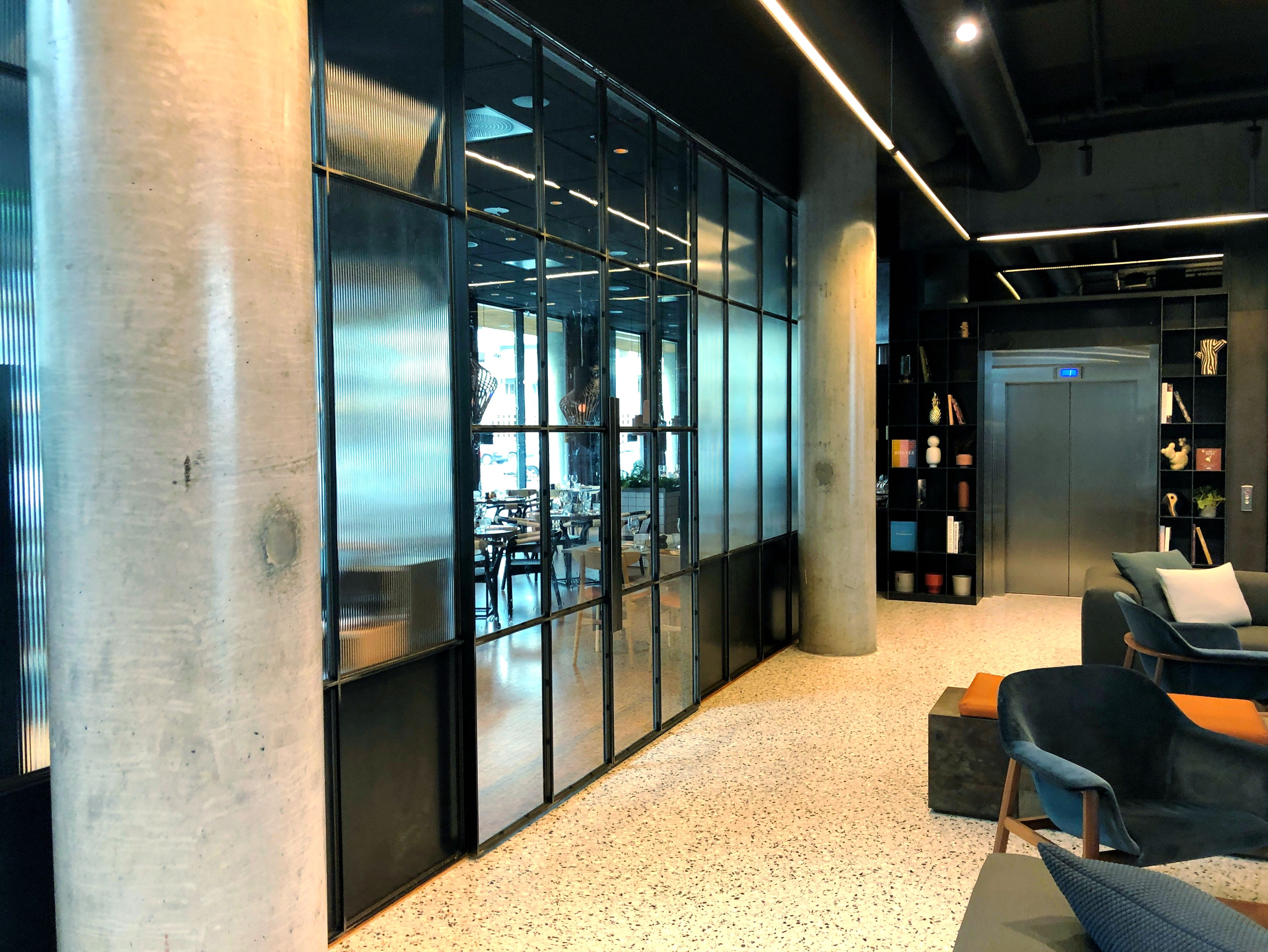 Glass and steel walls with double sliding doors in the midle…