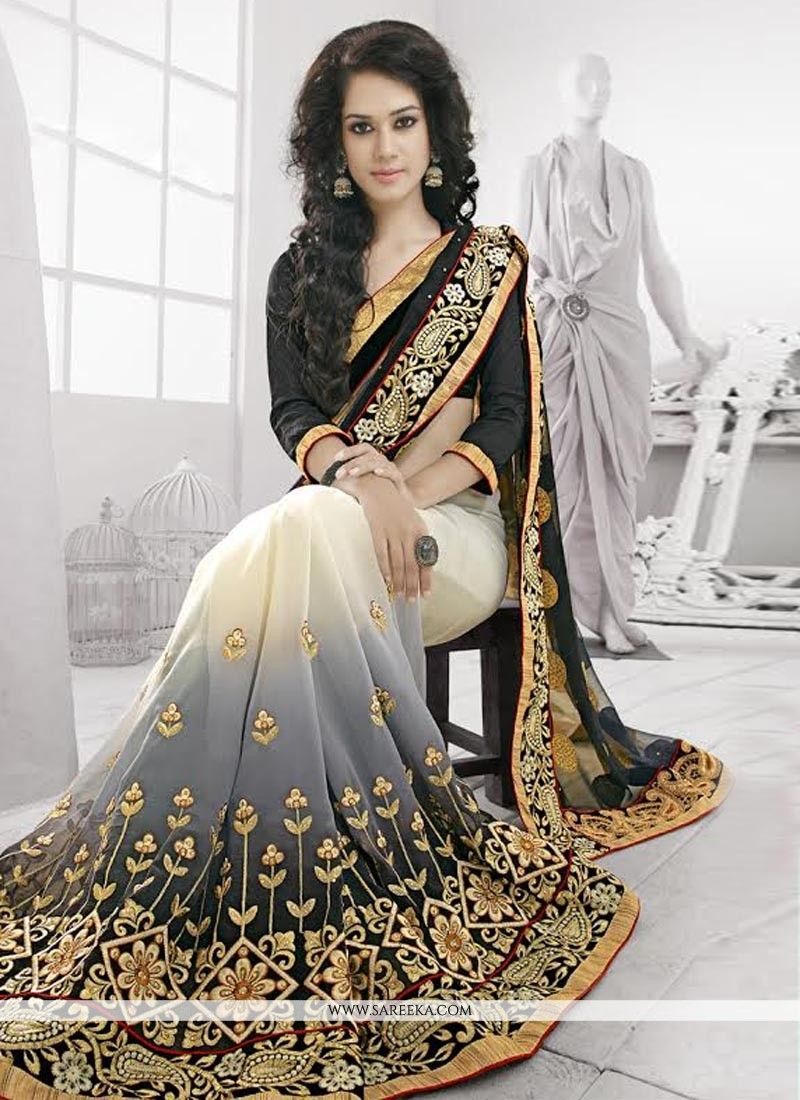 dbc088122e (Slight variation in actual color is possible).... Black and grey shaded  georgette and net designer saree ...