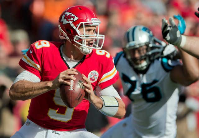 Kansas City Chiefs Quarterback Brady Quinn 9 Looked For An Open Receiver Avoiding The Rush Of Carolina Panthers De Greg Hardy Kansas City Chiefs Brady Quinn