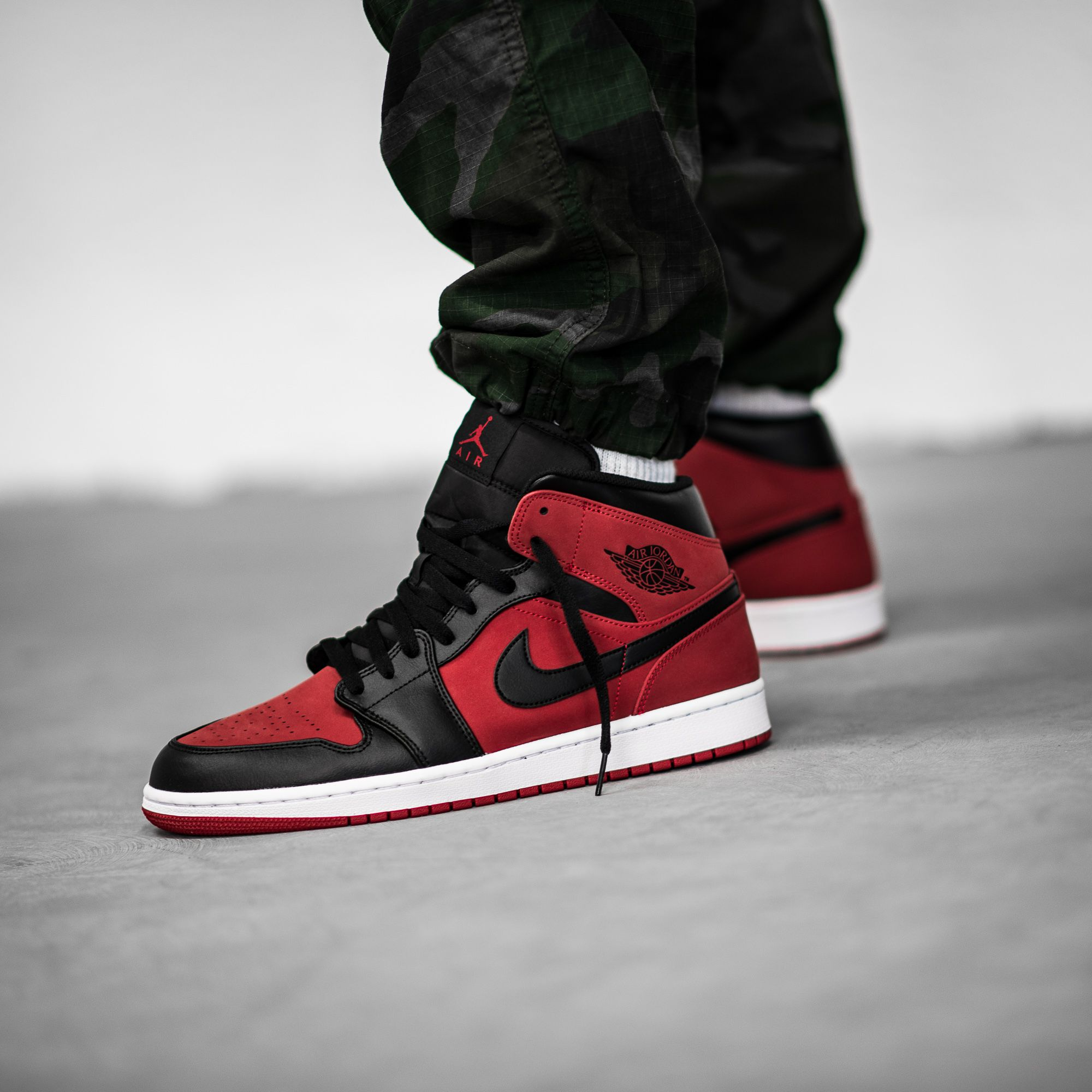 The Air Jordan 1 Mid In Gym Red Black White Is Now Available On