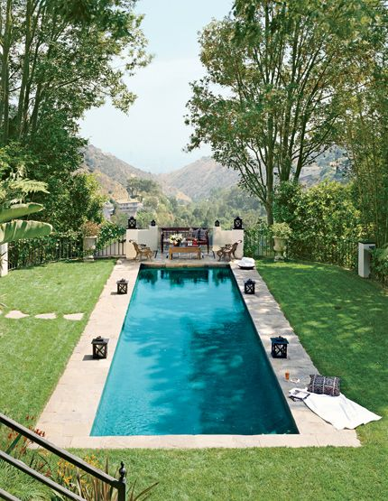 want this pool. the combination of the cool water and the shady trees looks like heaven.