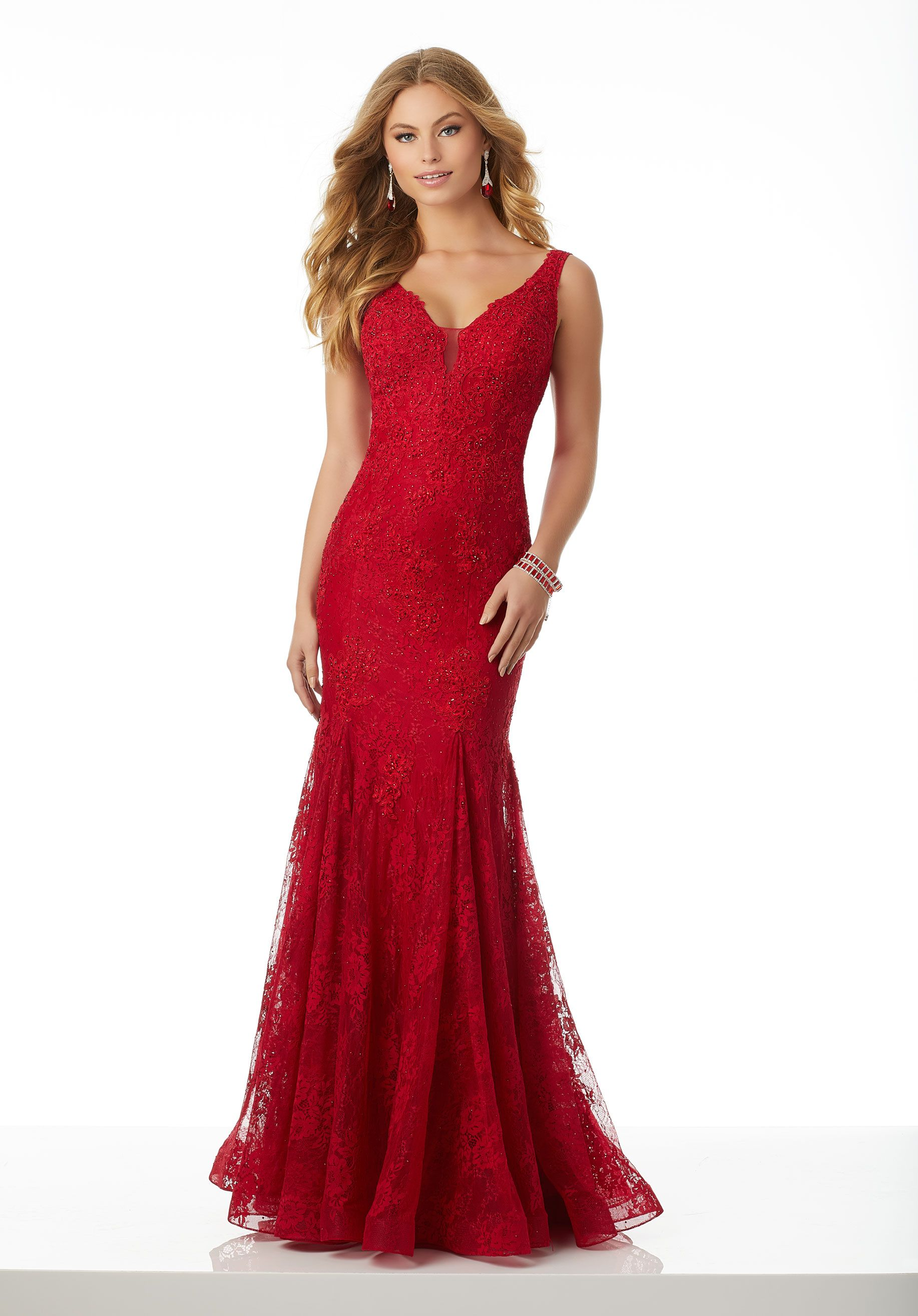 Gorgeous Strech Lace Prom Gown Accented with Beaded Appliqués. A Deep V- Neckline and Open U-Shaped Back Complete the Sexy Look 033068e75