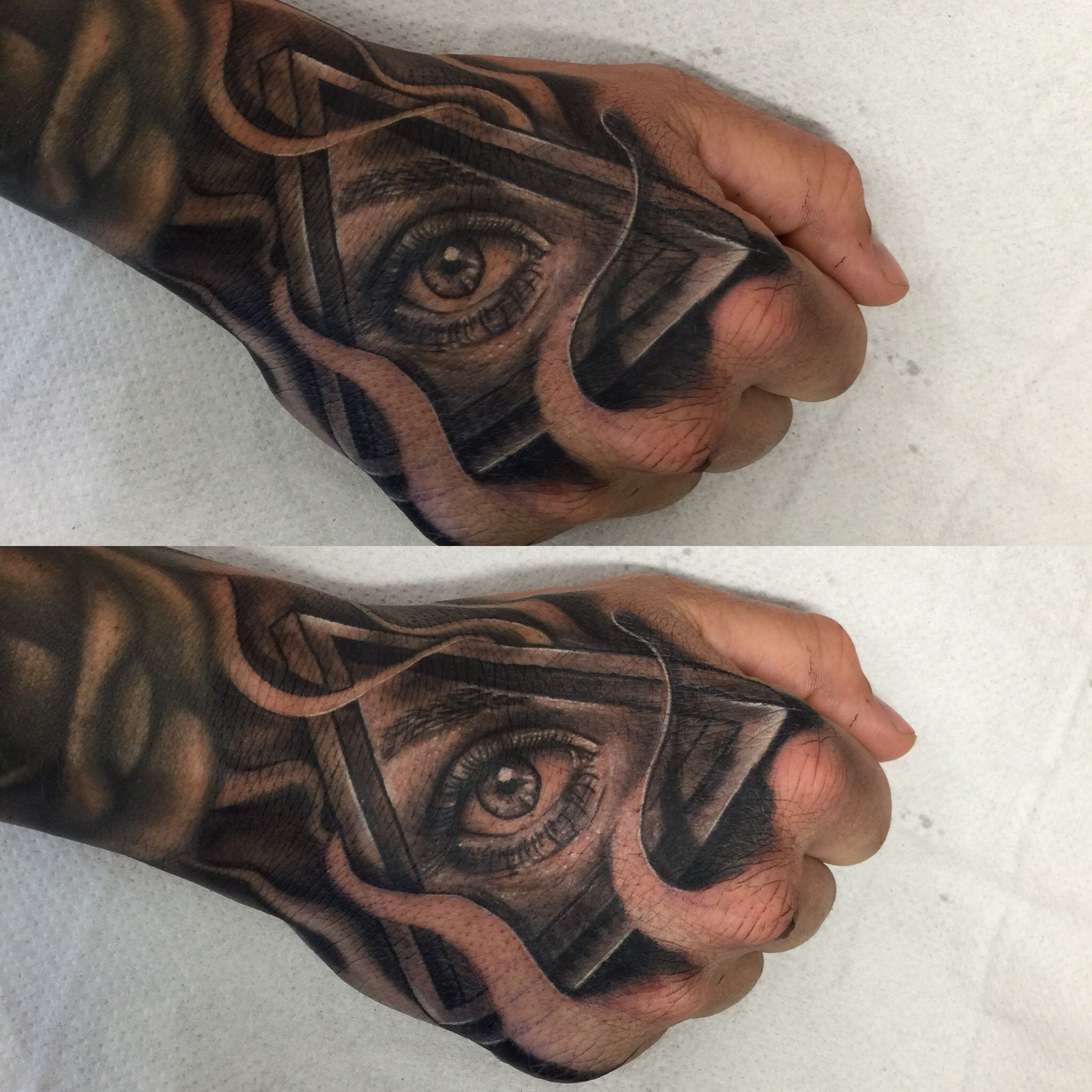 Hand tattoo optical illusion triangle and eye combo hope for Eye finger tattoo