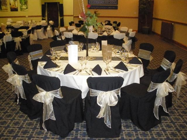 image result for tablecloth black chairs and gold sashes