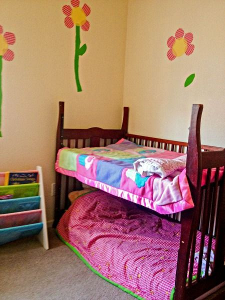 She Nails The Side Of A Baby Crib To Her Wall What She Hangs Off Genius Diy Toddler Bed Toddler Loft Beds Toddler Bunk Beds