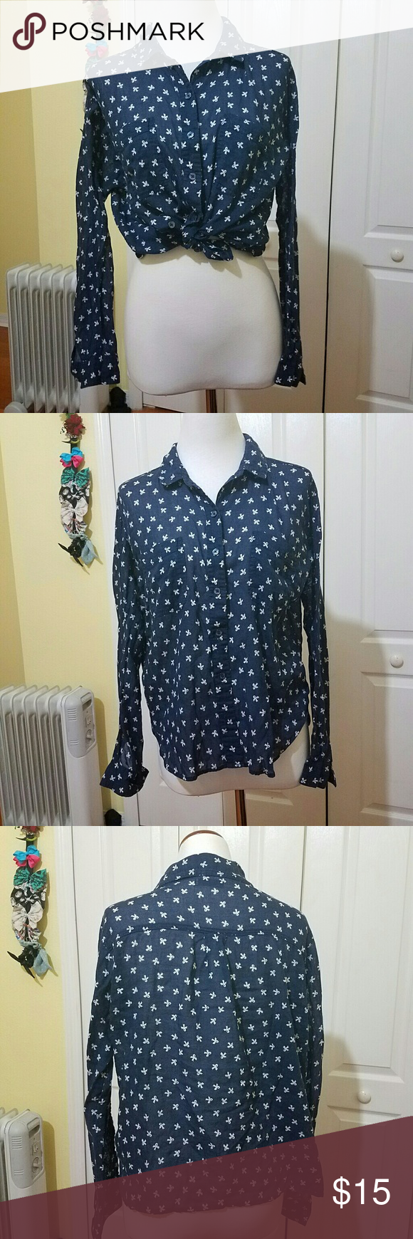 Sheer blue button down shirt Semi-sheer navy blue with little white bows, looks super cute tied up or open over a tank top! Excellent condition, super flattering cut, perfect for summer! BDG Tops Button Down Shirts