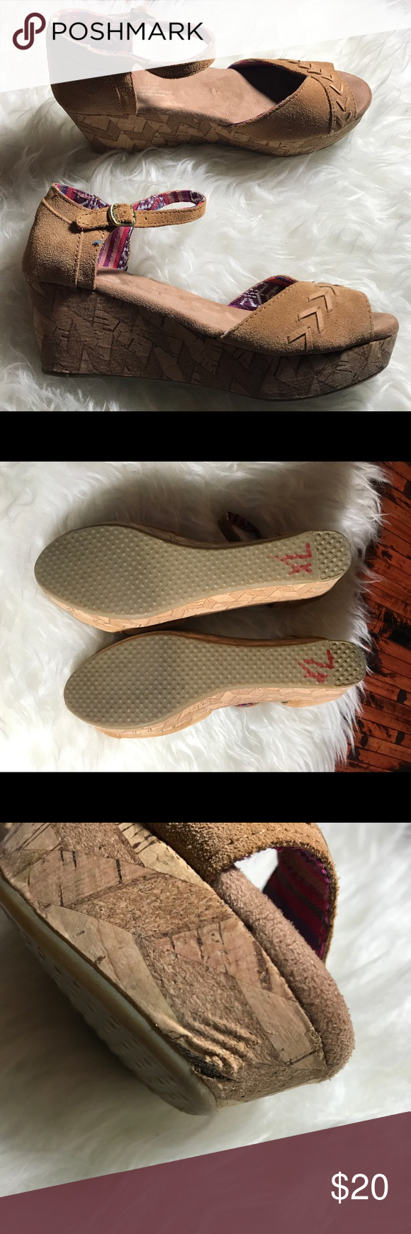 Toms Suede Wedge sandal size 7 Beige Toms Suede Wedge 2.4 Inch heel. Size 7 . Beige with aztec print inside. Ankle buckle. Rubber Sole. Small gashes on the heel as shown in picture . Stain on the back of the right heel as shown in pictures. Still wearable Toms Shoes Wedges