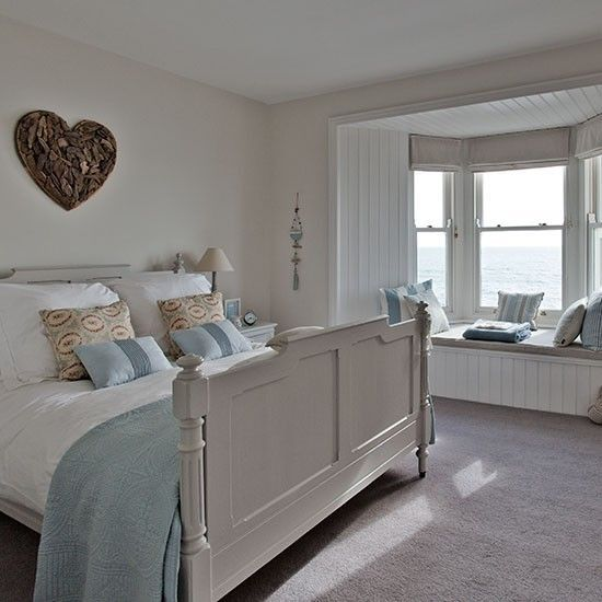 New England style bedroom with heart wall art | Step inside this