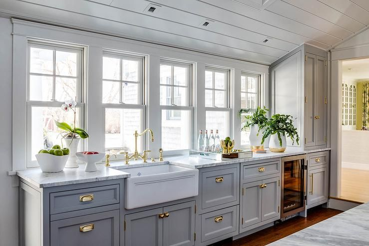 transitional light gray kitchen boasting a shaw farmhouse sink with a polished deck mount f on farmhouse kitchen grey cabinets id=20247
