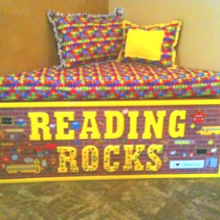 We made this for our second grade class project. We will auction it off at our annual fall carnival. It is a corner reading bench to make reading more fun!!