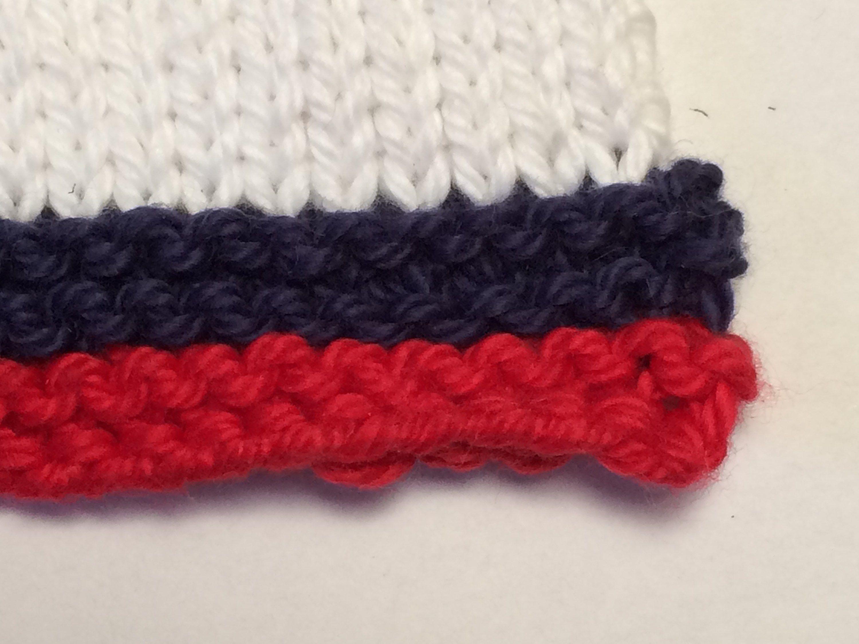 Weaving in Ends skimming Knitting, Red yarn, Weaving