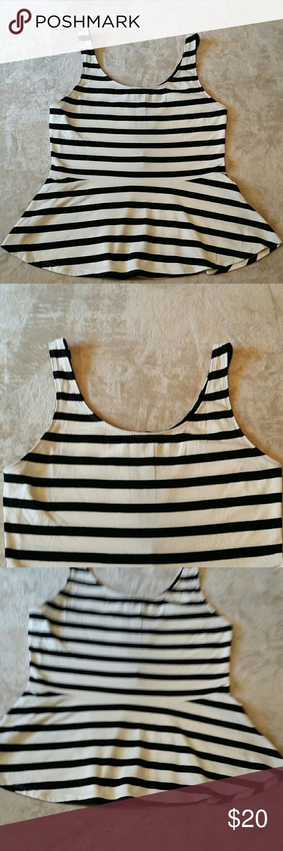 Black & white stretch  Express tank Black and white striped stretch  tank top . Size medium in excellent condition, barely worn.  95% cotton,  5% spandex. express  Tops Tank Tops