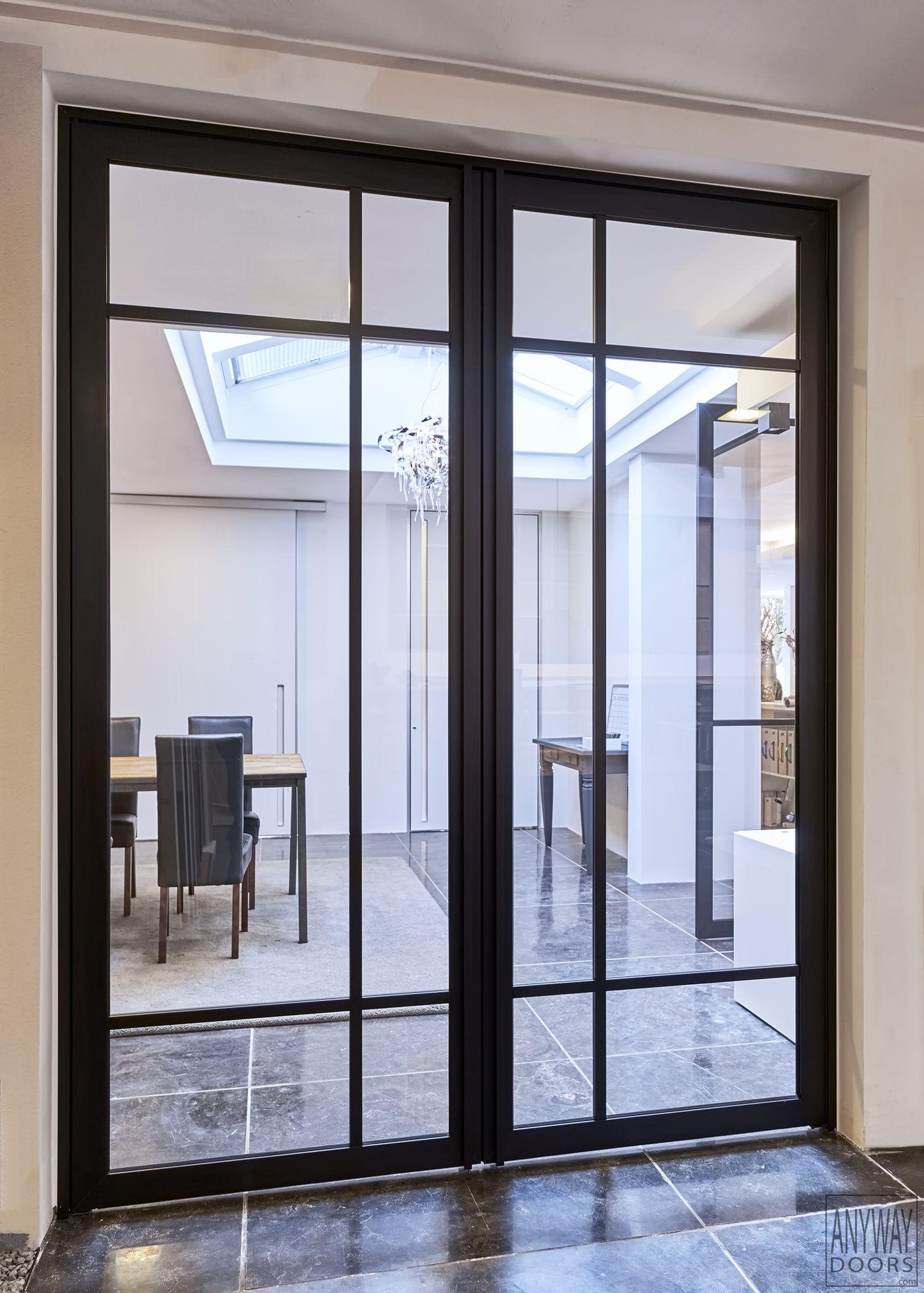 Double Steel Door Designed By Anywaydoors This Elegant Steel Look Doors Are Made From Black Anodized Aluminium Terrasdeuren Tuindeuren Terras Stalen Deuren