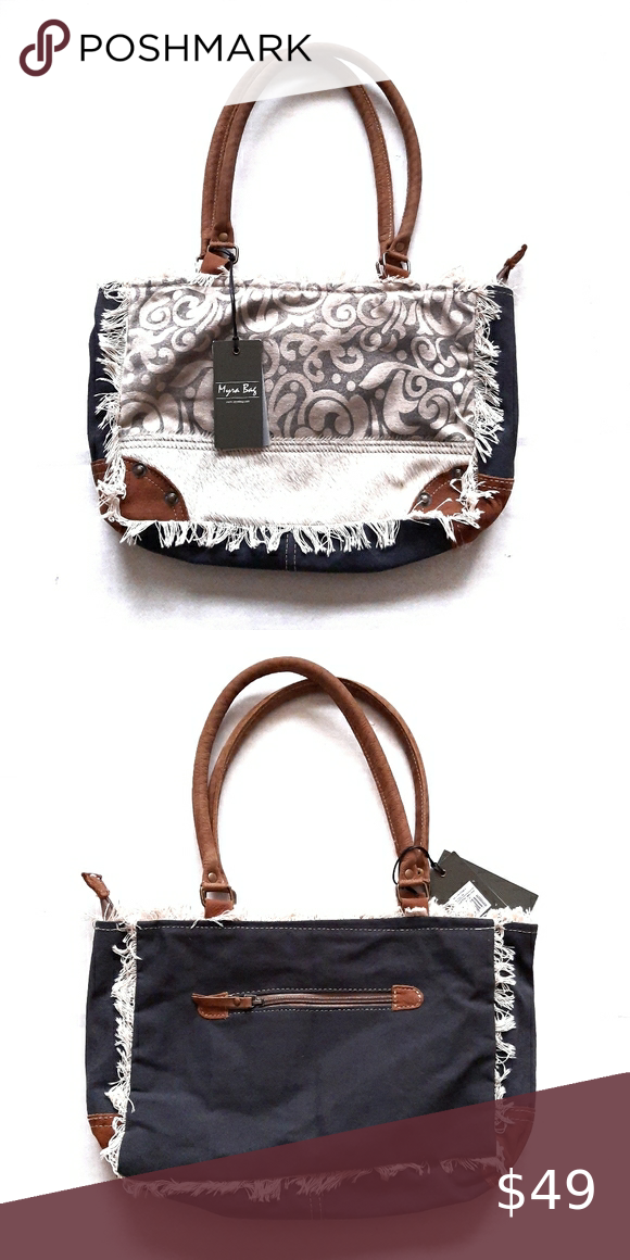 Myra Bags With Fringe : Every bag is truly handcrafted with spirit of vintage myra, a treat for nature lovers, is an endeavor to bring style, elegance, sophistication and quality.