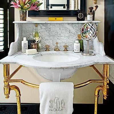 Brass Console Sink With Marble Backsplash