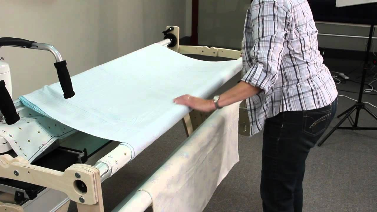 attaching fabric to a wooden Grace Quilting Frame | Loading a ...