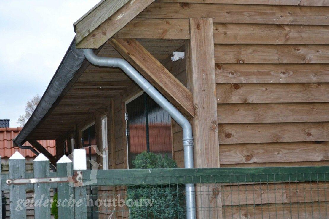 Zwarte schuur met terrasdeuren • Houten schuur op maat