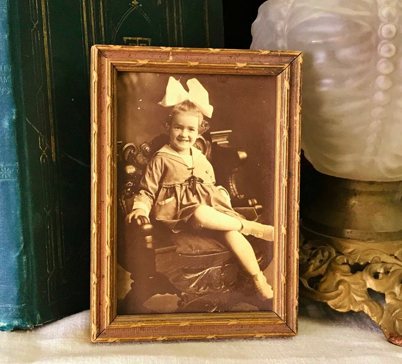 $35.00  Where can you buy an AnTIQUE SEPIA PHOTOGRAPH of GirL with BoW in WooD FrAME? Here and shes a real charmer. Shes sittin in a heavy Victorian chair with her legs crossed. #sepiaPHOTOGRAPH #VICTORIANphoto#NURSERYprints#vintageANTIQUEprints#childrenPHOTOS #WALLart#SepiaPhoto #WoodFrame#PictureFrame#SepiaGirlPhoto#GirlPhotograph#OldPhotograph  #AntiqueFrame#VictorianGirlHairBow#ChildSepiaPhotograph#GirlPhoto