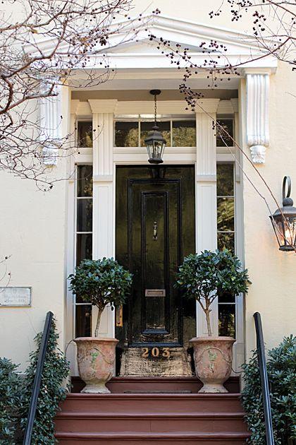 love this entry:  black door against white trim + walls || urn || trees || lantern