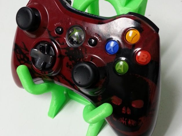 A stackable system for holding videogame controllers  Works