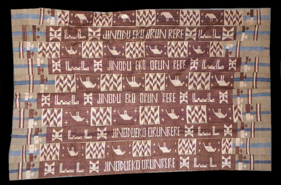 """Fine ca.1950s Yoruba aso oke with Arabic text. This style of aso oke with short texts executed in extra weft float was a brief fashion for ceremonial cloths used at weddings and funerals in the 1950s, but examples such as this one where the writing is in Arabic as well as Yoruba are extremely unusual. The Yoruba text reads """"Jinodu from Lagos sleep well"""", indicating it was woven for the funeral of a Lagos man called Jinodu, while the Arabic read """"God is Great."""" Dates from circa 1950"""