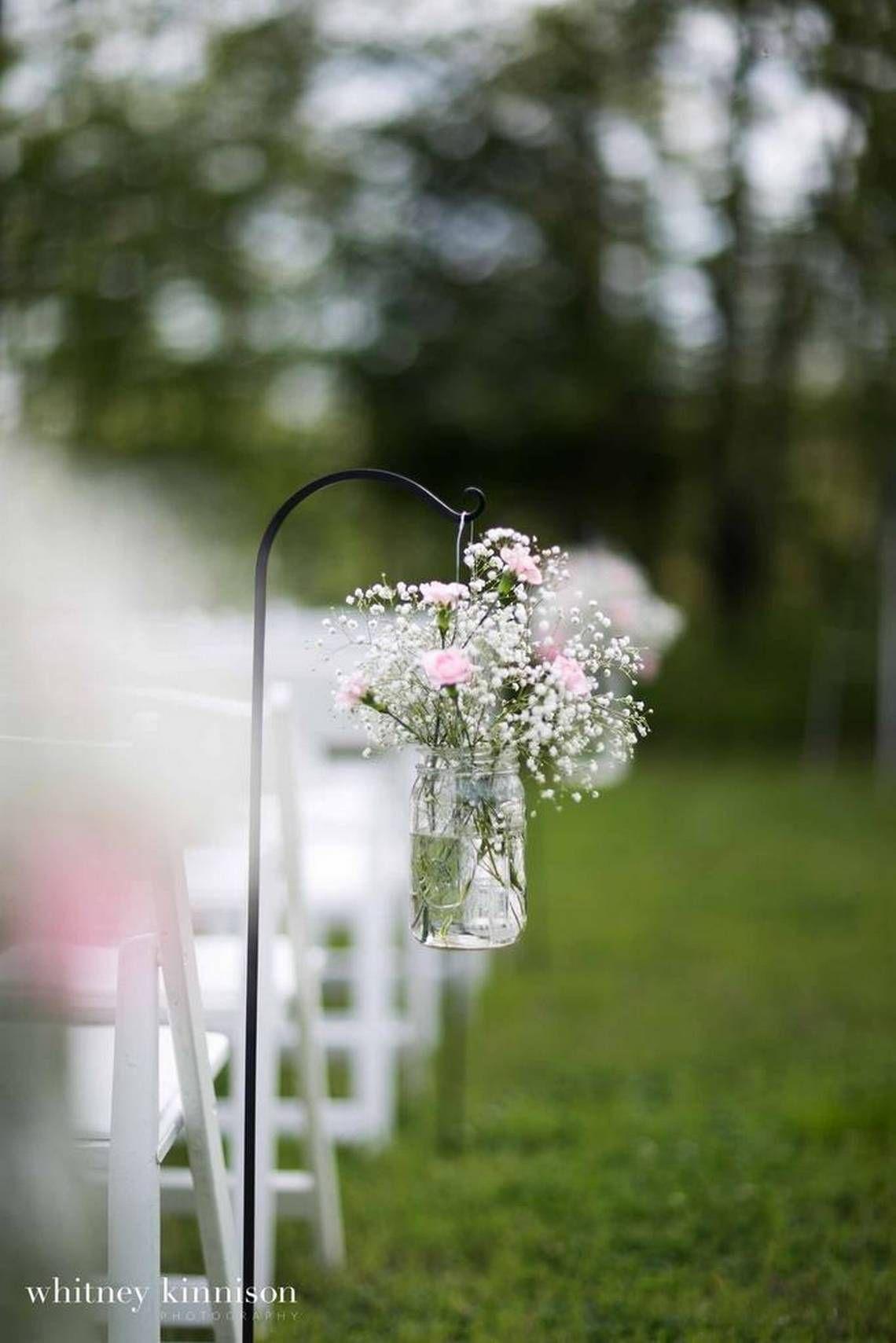 Wedding aisle decor ideas diy  DIY aisle markers were arranged with babyus breath and pink