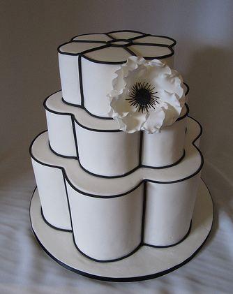 Three Tier White Wedding Cake In Flower Shape And Black Trim