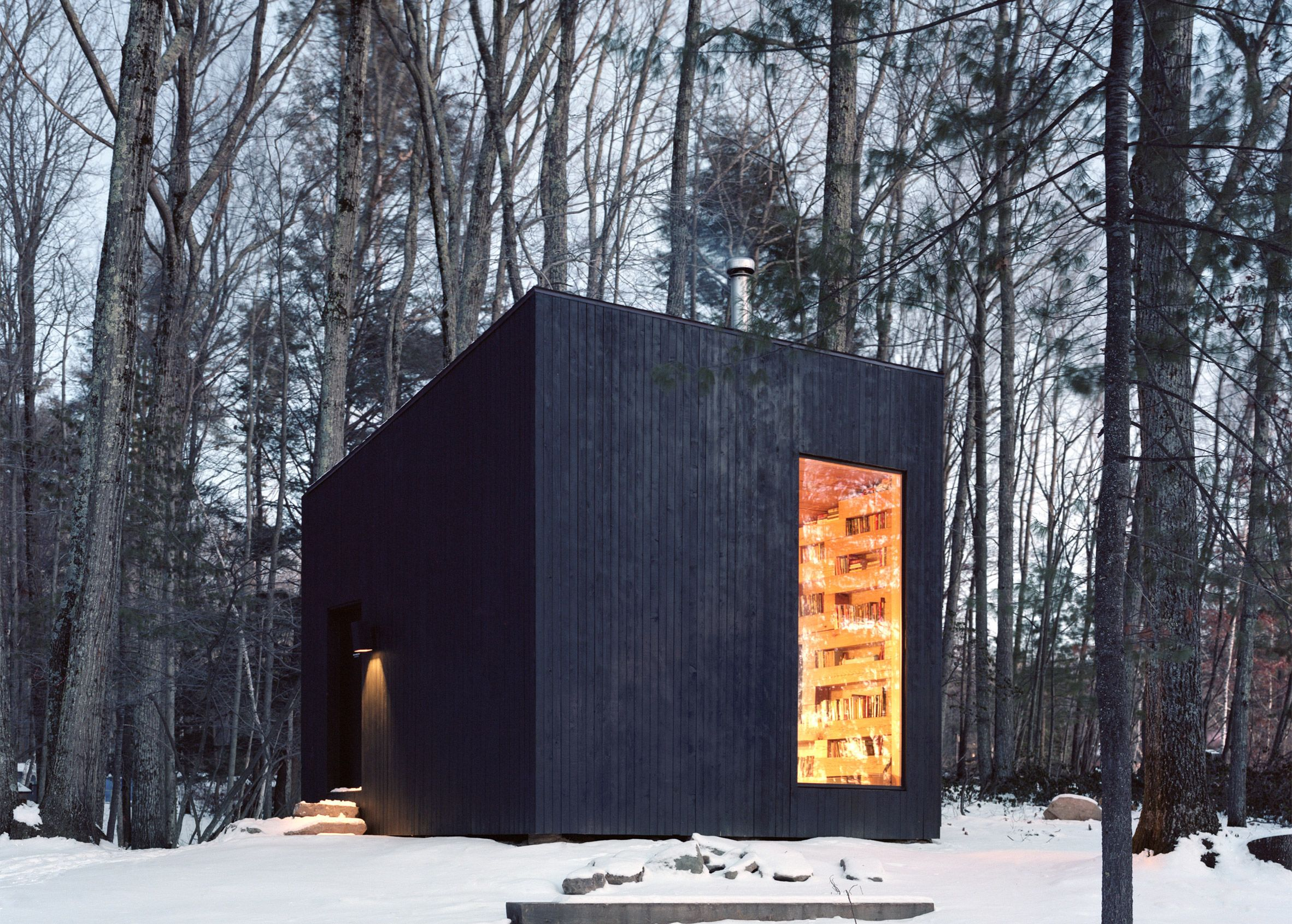 This tiny black cabin by US firm Studio Padron serves as the library ...