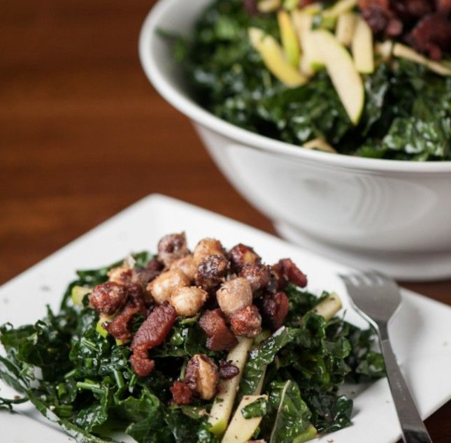 Mix up textures in your kale salad with candied hazelnut, apples + bacon.