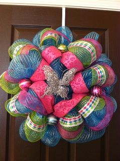 spring deco mesh wreaths, crafts, patriotic decor ideas, seasonal holiday d cor, Third wreath I like how this one came out Smaller wreath and used Deco Mesh on outside and inside to appear thicker
