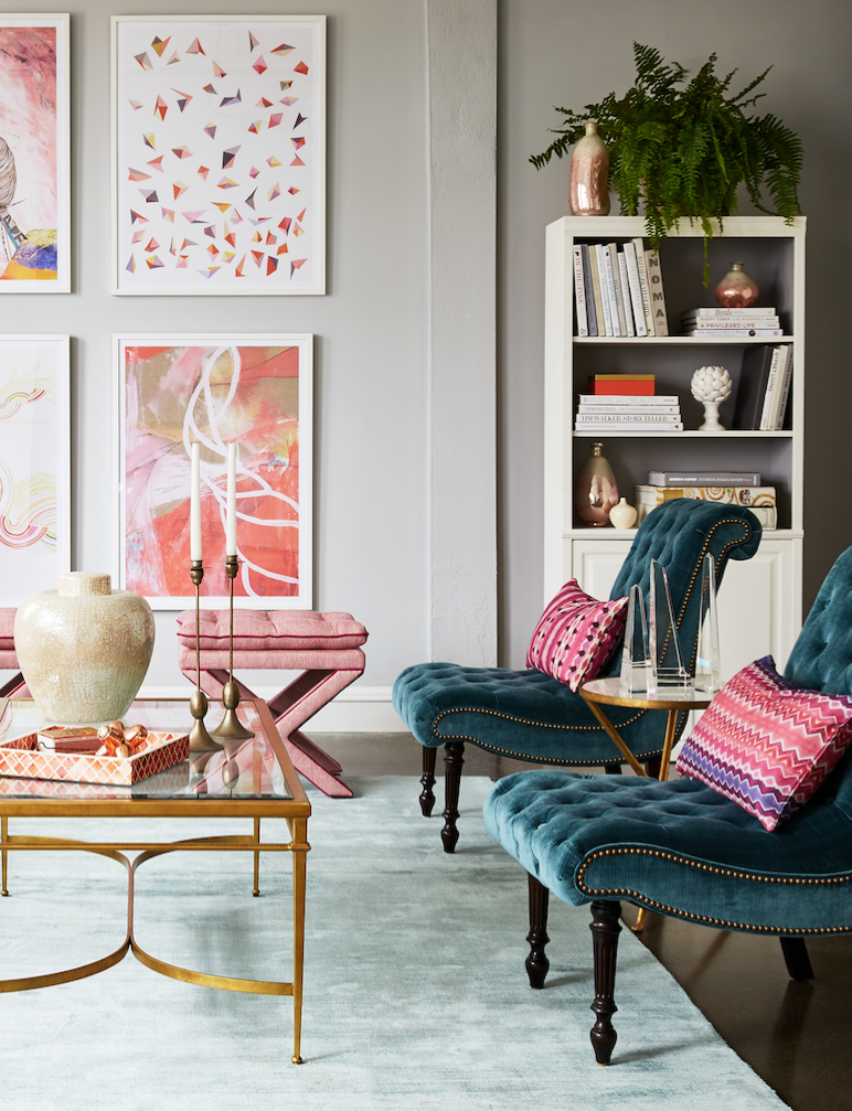 Sophisticated seating area with tufted velvet slipper chairs ...