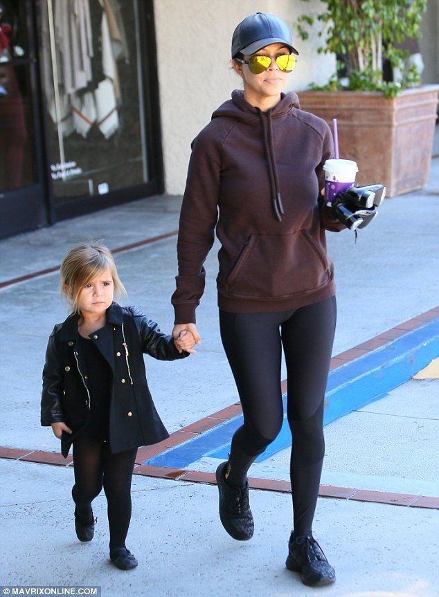 Stick with me! The doting mom held tightly to Penelope's hand as the two made their way into the dance studio