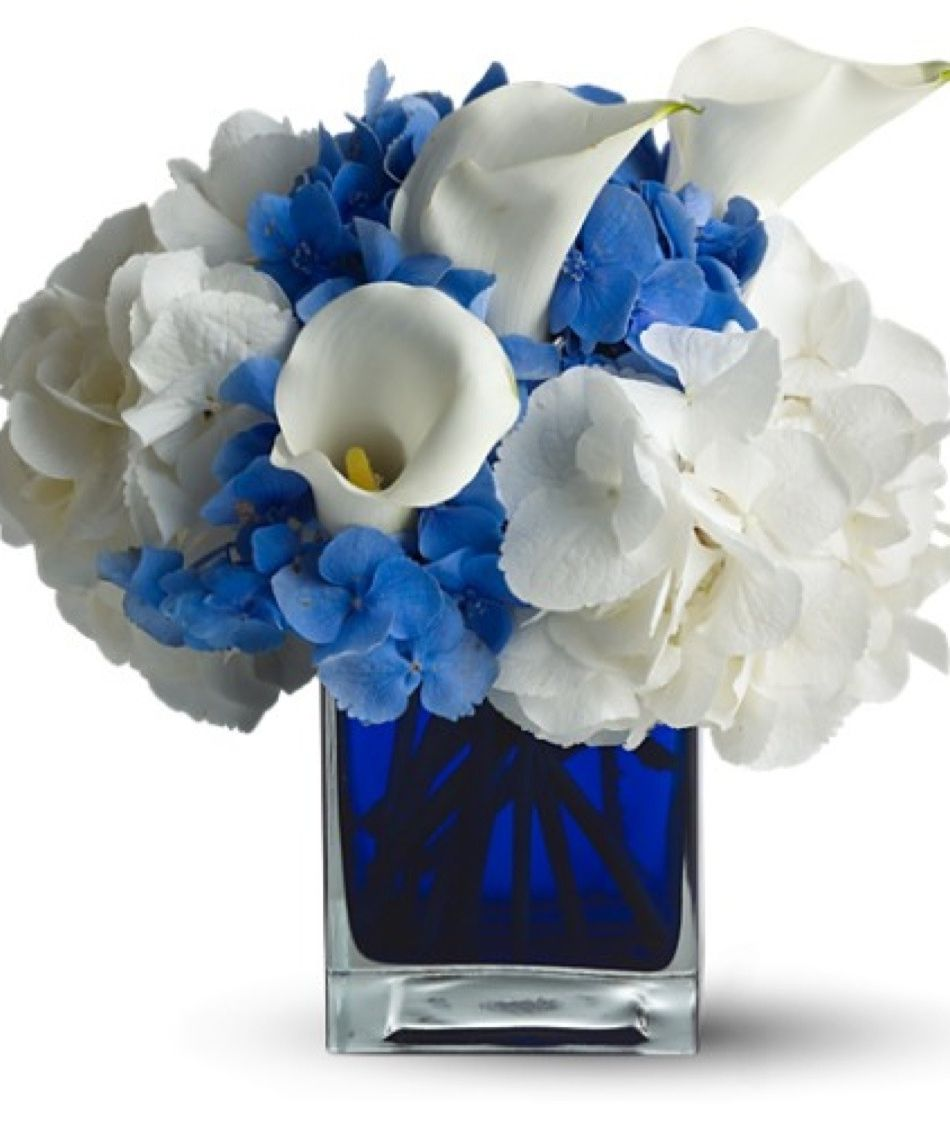 Blue hydrangea flower arrangement with vase here are
